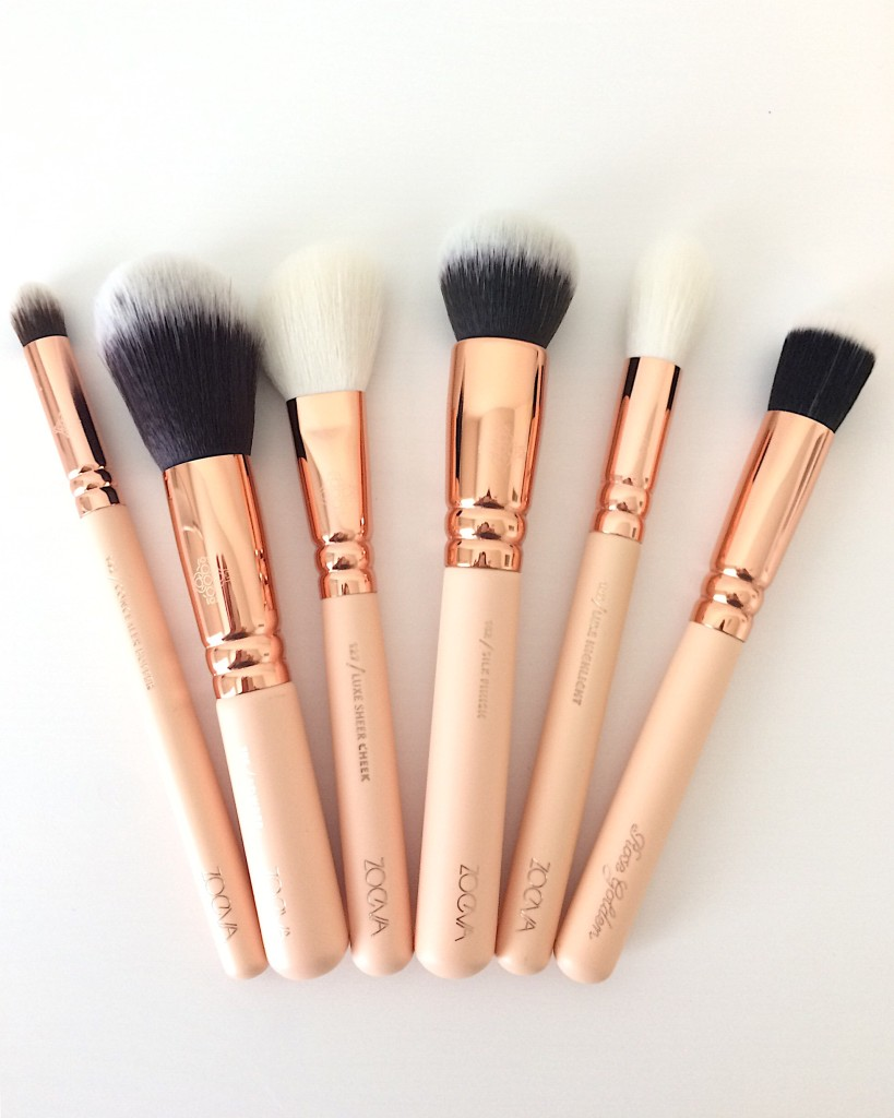 Zoeva rose gold and nude makeup brushes layed out