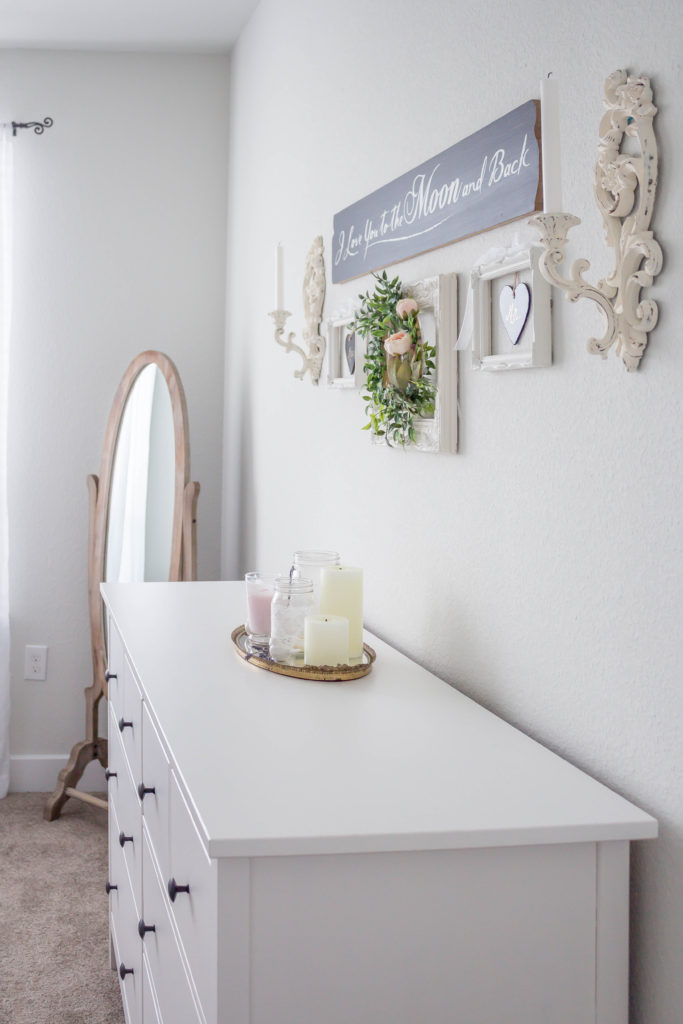 white dresser with gallery wall above