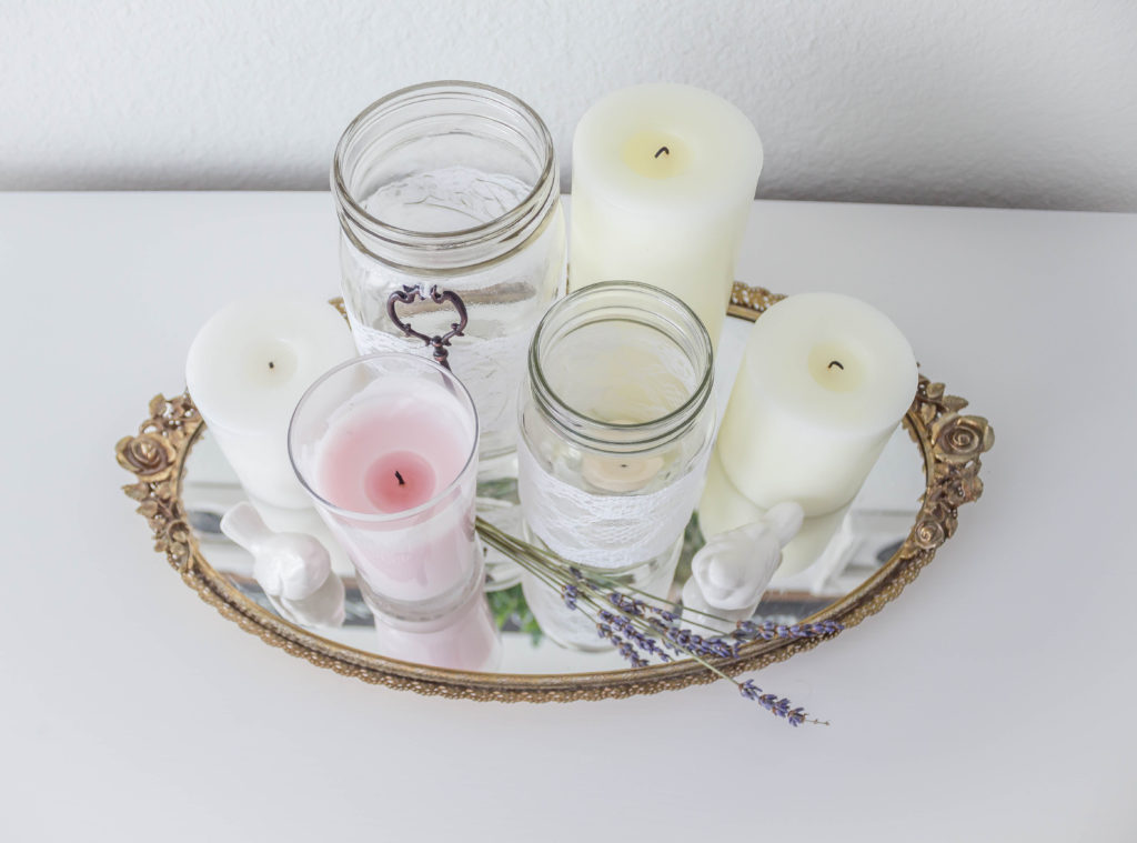 assortment of candles on vintage gold mirrored tray