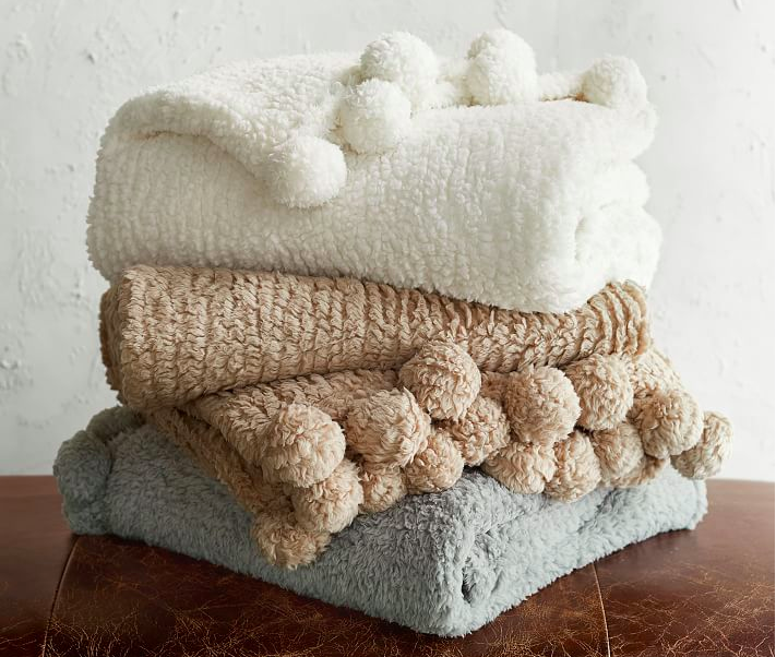 cozy pom pom throw