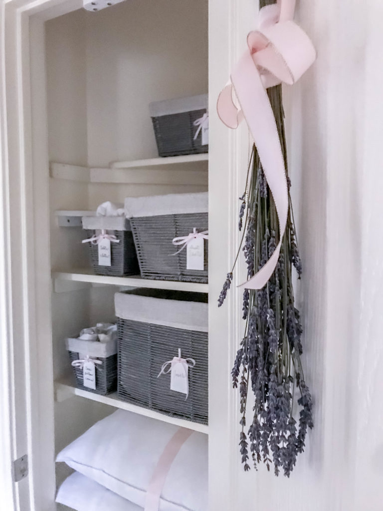 inside view of linen closet with lavender hanging on the door