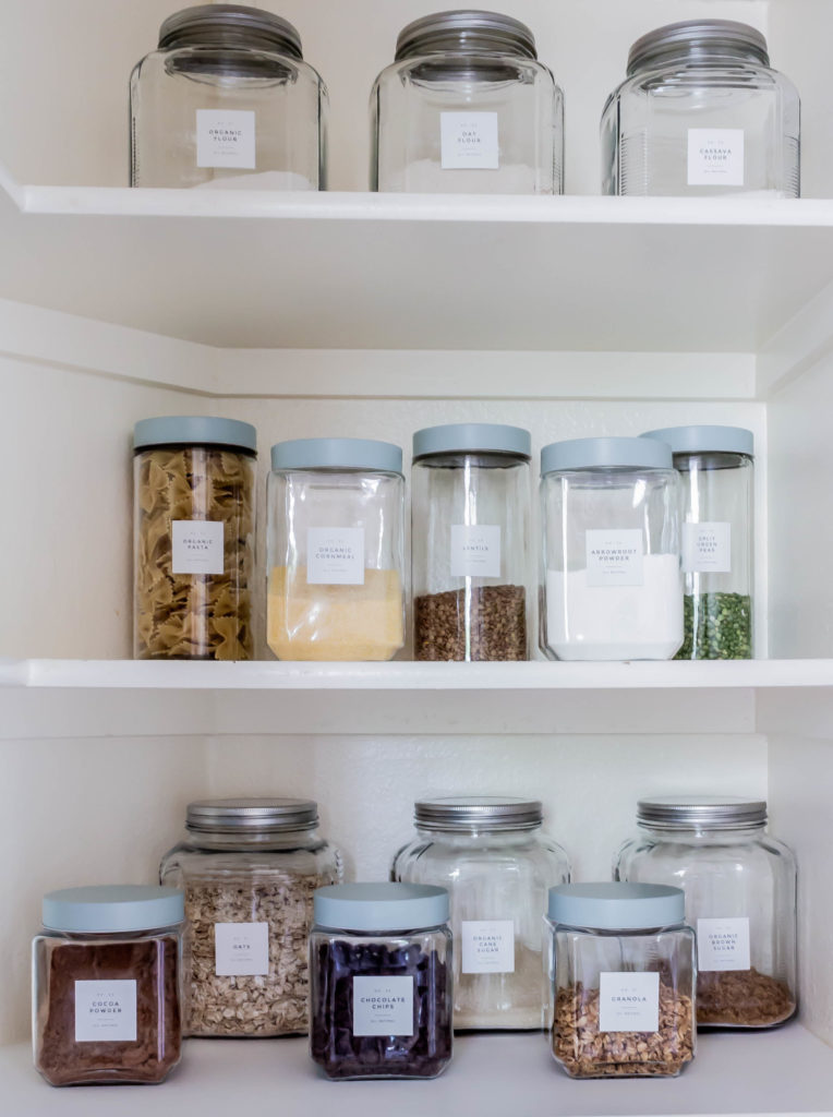 glass jars with labels filled with baking supplies