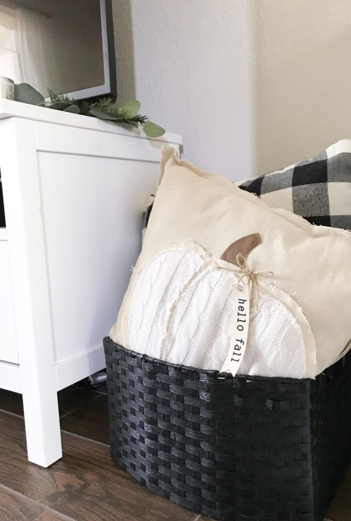 black basket filled with pillows